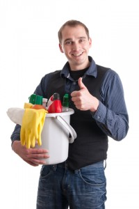 Man with bucket and cleaning supplies