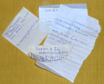 Contact information for new friends on scraps of paper